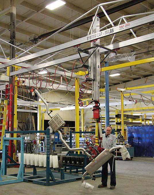 SC5 Slide Column manipulator with a very complex end effector for lifting and rotating exhaust systems by Givens Lifting Systems Inc.