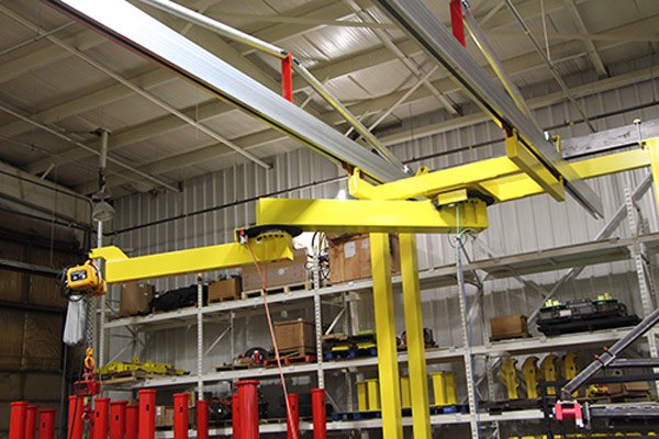 AJ200 articulated jib crane mounted on C2000 bridge crane rail