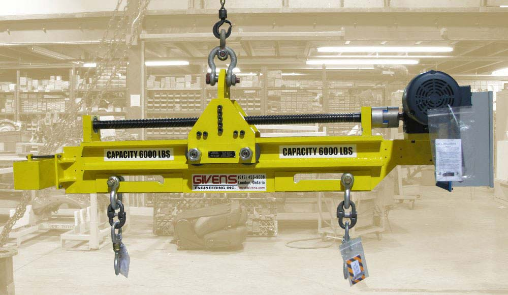 load leveling spreader beam and frame lifters