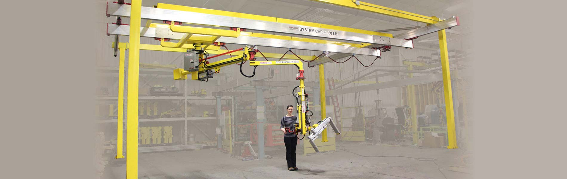 Bridge crane mounted industrial manipulators designed in the US by Givens Lifting Systems Inc.