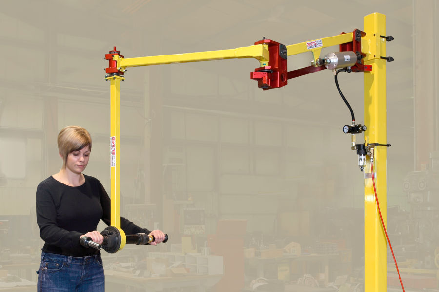 A TA2 torque arm mounted overhead. Toolholder mounts the nutrunner allowing a 360-degree spin.
