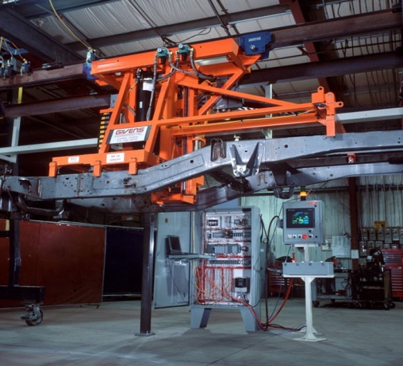 Automated truck-chassis transfer grips, lifts and transfers
