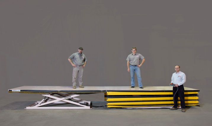 Hydraulic tandem lift platforms for auto assembly line workers