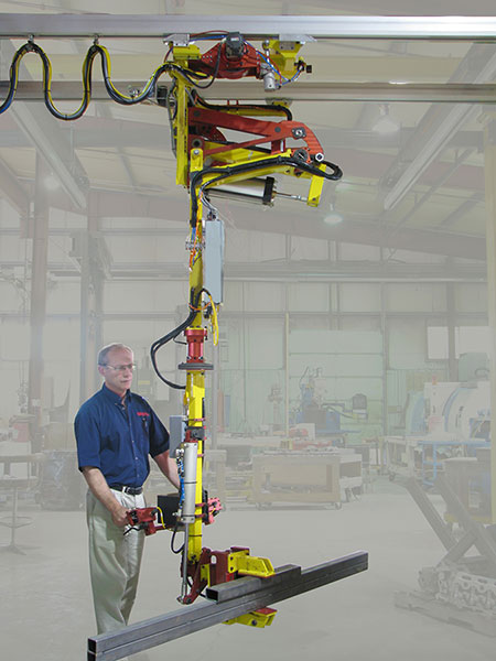The crane arm balances the weight pneumatically using a compound arm with the operator pulling up and down on the handlebars to cause vertical movement.